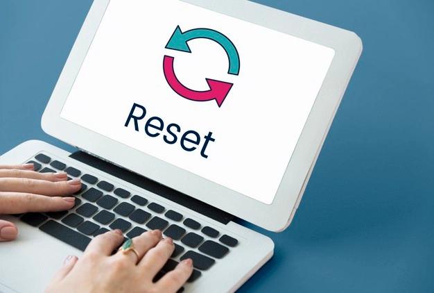 Laptop showing Reset Symbol